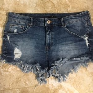 Perfectly distressed dark blue denim shorts
